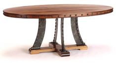 Frisco Oval Dining Table Western Dining Tables - Rosa Morada plank wood top and legs of hammered steel with rivets offer a rugged look with contemporary appeal. Table is available in three sizes. Unique, hand made furniture created by traditional craftsmen preserving timeless quality techniques.