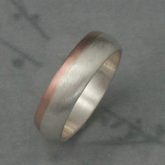 Solid 14 Rose Gold and Silver Rounded Wedding Band--Two Tone Wedding Ring--Modern Mens Band. $235.00, via Etsy.