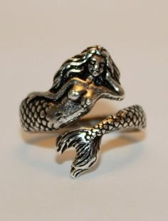 """Mermaid ring that the mermaid gave them. """" here. Take this. """" she said taking the ring off her finger and handing it to one of them."""