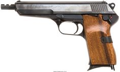 CZ Model 52 Semi-Automatic Pistol. Serial no. E19722, 7.62mm, 5 5/8-inch barrel with integral recoil compensator. Blued finish. Import stamps. Dated 53. Checkered walnut grips. Lanyard loop.