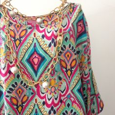 """Lilly Pulitzer """"Crown Jewels"""" Silk Trace Top Very pretty """"Crown Jewels"""" pattern in the split shoulder Silk Trace style top from Lilly Pulitzer. In excellent condition. 100% Silk. Dry clean only. No trades or Paypal please. Lilly Pulitzer Tops"""