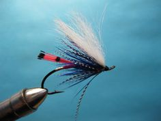 The Dec Hogan Summer Bug is tied with seriously fishy materials. A hot pink butt, purple body, mylar rib and two hackles topped with an arctic fox wing. What steelhead could pass this pattern up?