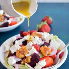 Strawberry and beetroot salad with candied walnuts and tossed in sweet and tangy honey-mustard dressing.