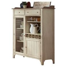"Showcasing a weathered ivory and maple finish, this versatile rubberwood cabinet provides ample storage for dinnerware and home bar accessories.   Product: CabinetConstruction Material: Rubberwood and maple veneersColor: Weathered ivory and mapleFeatures:  Holds five bottlesTwo drawersTwo doors Open shelf storageDimensions: 63"" H x 47.63"" W x 19"" D"