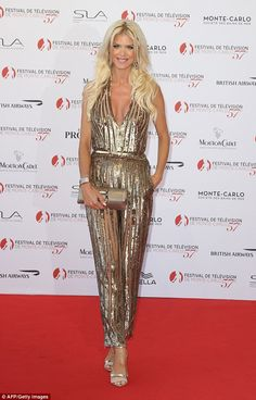 Golden girl:Adding further glam to proceedings was Victoria Silvstedt who dazzled in a show-stopping gold jumpsuit, seemingly borrowed straight from the Seventies
