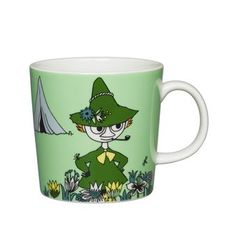 The Arabia Moomin Snufkin Mug brings to life this character found in the Finnish book by Tove Jansson. This porcelain mug features a beautiful and colorful illustration of this unique character to enjoy while sipping your favorite beverage. Moomin Shop, Moomin Mugs, Moomin Books, Green Coffee Cups, Green Mugs, Nordic Design, Scandinavian Design, Troll, Moomin Valley