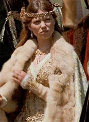 Robin Hood (2010) - Léa Seydoux asIsabella of Angoulême wearing a gold brocade dress with heavy gold and aquamarine embellishments worn with a fur-trimmed mantle. Her necklace and tiara are decorated with cabochon stones.  The costumes were designed byJanty Yates.