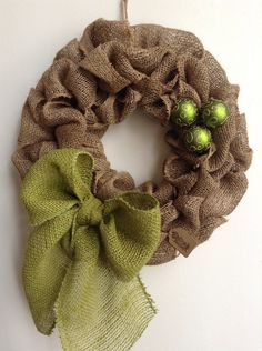 Burlap Christmas Wreath our Bubble Style, shown in Natural and adorned with an Avocado Burlap Bow and matching ornaments