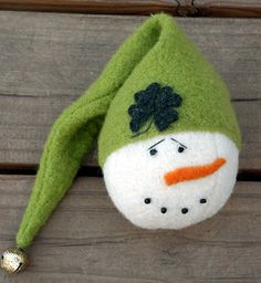 Snowman Ornie Primitive Snowman Irish Green Shamrock Ornament OFG Team. $15.50, via Etsy.