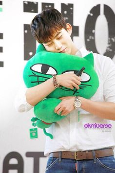 OK Taecyeon CEO with his OkCat plushies