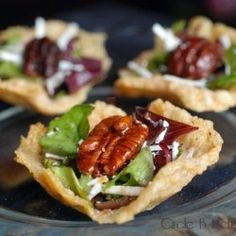 Little appetizers of Parmesan frico cups filled with balsamic-dressed salad, grated ricotta salata & a caramelized pecan.