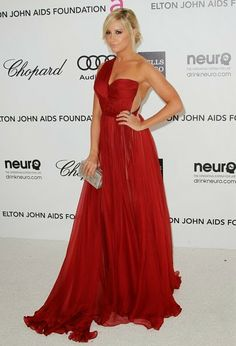 Ashley Tisdale in a stunning vaporous red gown