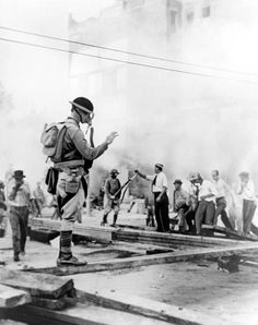 General McArthur's troops using gas bombs to subdue the Bonus March Veterans after they are told to leave the premises. (image from the Associated Press)