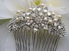 Vintage Inspired  Pearls bridal hair comb by EverythingBride,   like the shape! again has your pearls and bling