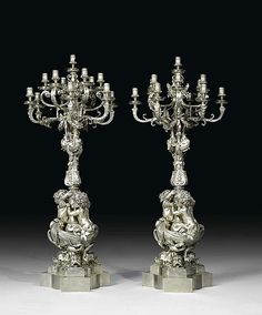"*<b>PAIR OF IMPORTANT CANDELABRAS ""AUX ANGELOTS"".</b></i> Late Louis XV, Paris, 2nd half of the 19th century. <br>Silver-plated bronze. The screws on the nozzles replaced. H 110 cm. <br><i>Provenance: from an English collection, acquired in South America. <br>Matches previous lot. </b></i> <br><b> CHF 15 000.- / 25 000.- <br>€ 9 690.- / 16 160.-</b>"