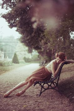 Inspirational image #3.;  This image of the girl in a garden is perfect for my concept as it looks as if she is lost in thought, in her own secret place [garden]. The trees in the background are absolutely beautiful. They are large  full and give the picture that little extra something to fill in the space. Everything about this picture just makes this place so comfortable, peaceful  enjoyable in a secret kind of way.