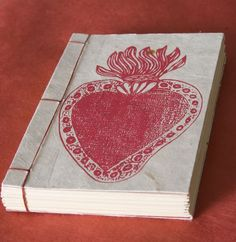 6x4 in. Heart journal Japanese stab binding.Hand-Binded with red waxed Irish linen. Comes with 48 pages 80lb ivory paper.the paper is hand-made from Nepal. great for jotting notes.