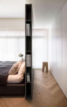 Living ideas bedroom - use the space behind the bed- Wohnideen Schlafzimmer – den Platz hinterm Bett verwerten small modern bedroom with gray partition as bookshelf, built-in wardrobe white, parquet floor and white blinds - Bedroom Wardrobe, Home Bedroom, Bedroom Ideas, Bedroom Decor, Wardrobe Wall, Library Bedroom, Bedroom Designs, Bedroom Furniture, Bedroom Flooring