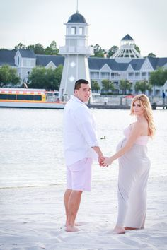 Maternity photos shoot with Jessica June photography in Orlando Florida at the Disney Boardwalk