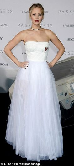 Cool blonde: Her white dress featured a full tulle skirt and an embroidered heart over her left breast, while the back consisted of three straps fastened with silver buckles