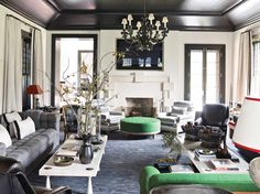 The Gambrel-designed club chairs and ottoman are upholstered in Schumacher and Pierre Frey fabrics, respectively, and the limestone mantel was custom made by Jamb. A Hamptons Home Reborn - ELLE DECOR White Rooms, White Walls, Black Walls, Pantone Verde, Hamptons Living Room, Living Room Designs, Living Spaces, Living Rooms, Dark Ceiling
