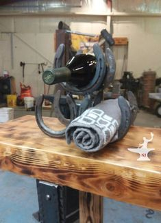 New reduced price on sale now 3 bottle/towel holder made from upcycled horseshoes from here in wyoming free and fast shipping. Custom Wine Bottles, Cody Wyoming, Wine Bottle Holders, Western Homes, Horseshoes, Cabinet Handles, Towel Holder, Wall Hooks, Blacksmithing