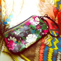 Boho Floral Glossy Wristlet Boho Glossy Wristlet in Floral Motif w/ Velcro side slot and card holders. Make an offer! Bags Clutches & Wristlets