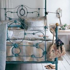 antique iron bed painted a beautiful robin's egg blue