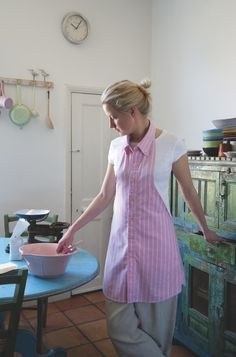 Button Down Shirt Apron. Recycle an old found shirt, being sure it's washable. Turn the sleeves into front hip pockets or apron ties.