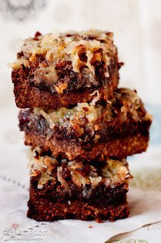 Fudgy German chocolate brownies with brown sugar pecan crust and topped with homemade coconut-pecan topping