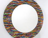 brightly colored round mirror, wall art- made from recycled magazines, blue, green, red, purple, pink, yellow, orange. $275.00, via Etsy.
