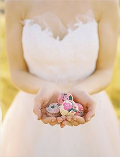 hand painted macaroons for wedding dessert #weddingdessert #macaroons #weddingchicks http://www.weddingchicks.com/2014/02/14/dinner-for-two-wedding-ideas/