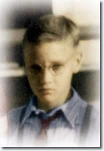 Elvis as a boy with glasses