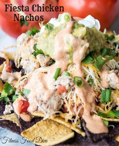These Fiesta Chicken Nachos are just what you need for Superbowl Sunday! Nachos are the perfect snack and these healthy Fiesta Chicken Nachos are loaded with lean protein, heart healthy fats, and fiber.