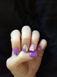 Purple chevron nails with silver glitter accent nail and a purple heart.