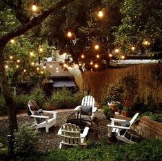 Backyard Makeover - love the idea to put lights in the trees so the kids could have a good night reading and family time!: