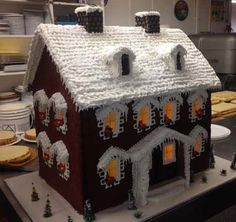 Phoenix-Arizona-five-foot-high-custom-Christmas-Gingerbread-house--  http://www.cakes3.com/gingerbread.htm 866-396-8429 call 24/7 delivery 1 hour in all 50 states   We are experts at using our resourses and your emailed pictures of your biulding, to copy it and make it look like you house or home. Some of them have garages, the gingerbread houses can have lights on them that you plug in to light up