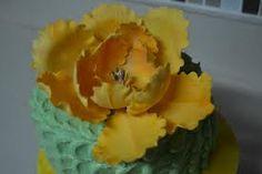 orange ruffle flower cake