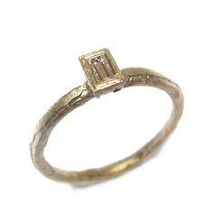 Diana Porter - 9ct yellow gold etched band with 0.14ct baguette cut white diamond