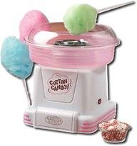 This genius of a machine can take any hard candy, and I mean ANY hard candy and make it into fluffy cotton candy! Can you imagine? Jolly Rancher cotton candy! Candy cane cotton candy! Butterscotch cotton candy! The possibilities ...will have to try this for our next party