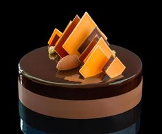 Chocolate mousse( Cocagne noir) - orange/ginger compote- biscuit moulleux…