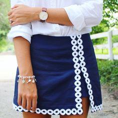 Wellesley Row charm bracelets. Lenore Lilly Pulitzer skort. Polo Oxford button down. @dailydoseof_prep on Instagram