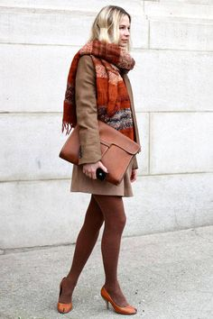 A local stylist wears a Zara scarf and jacket, Uniqlo skirt, Michel Vivian shoes, and vintage bag.    - ELLE.com