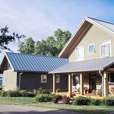 No Painting Necessary - I love my stucco home, and this one is a modern update with standing seam metal roof
