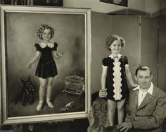 A vintage press shot of Hollywood legend Shirley Temple standing by her painted portrait, circa 1930s!