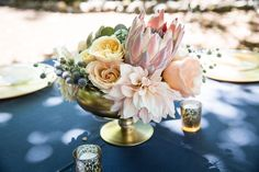 Centerpieces with king protia, cafe dahlias, peach david austin roses, thistle and succulents by EV Floral Design and photo by Elle Jae Photography