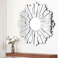 Add a useful mirrored surface to your room while providing a decorative touch as well with this lovely round wall mirror. The mirror is crafted of glass and wood and colored silver to attract instant attention from anyone entering the room.
