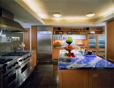 """Countertop. This rich royal blue color is known as """"Sodalite"""". The blue gives an unexpected touch to the overall design"""