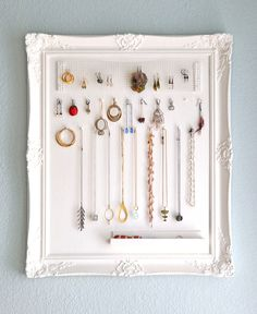 diy jewelry holder- I like all the different sections a good way to hold everything.