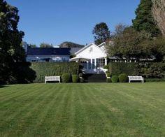 Charming farmhouse nestled on sprawling gardens